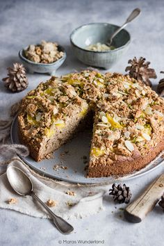 Winterlicher Orangen-Mandel-Kuchen: ein gesunder Rührteig aus Dinkelvollkornmehl wird belegt mit filetierten Orangen und bedeckt mit Hafer-Mandel-Streuseln.