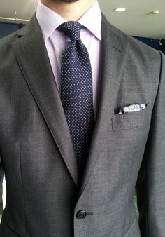 Grey suit, lavender shirt, navy tie with white pin dots