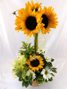 Sunflower and Bees Topiary - Stalks of Sunflowers grow from a bed of greenery and daisies bringing summer to your recipient. It is accented with swirling bees that bring the whole scene to life! Topiary Centerpieces, Sunflower Centerpieces, Sunflower Arrangements, Fall Arrangements, Floral Centerpieces, Sunflower Party, Wedding Toasts, Flower Delivery, Fresh Flowers