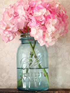 Simple bouquet idea: pink mophead hydrangea in blue mason jars.