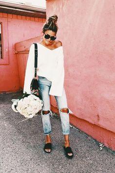 Off the shoulder, slides + distressed denim. white off the shoulder sweater with black slides and distressed light wash denim and oversized black sunglasses- spring outfit