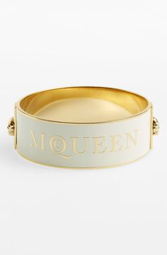 Finish off an outfit with this Alexander McQueen wide logo bangle.