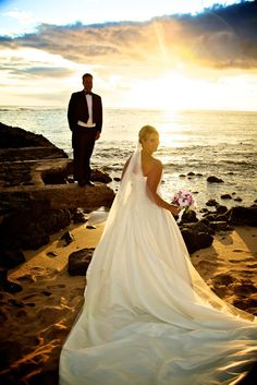 A beautiful shot of the Bride & Groom at Prince Kuhio Beach, following the oceanfront ceremony at The Beach House.