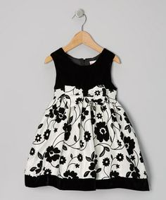 Dressing to the nines will be quite the fuss-free affair when this fancy frock is invited to the party. In addition to a posh floral pattern, it boasts a matching bow and handy-dandy zipper in the back.