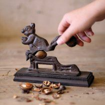 I love that you crack nuts with the squirrel's butt!   7.5 in. Cast Iron Squirrel Nut Cracker