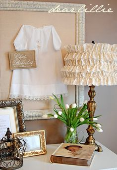 For a baby room - love the framed baby clothes, shoes, bonnets, and of course the ruffled lamp shade - tutorial on the lamshade