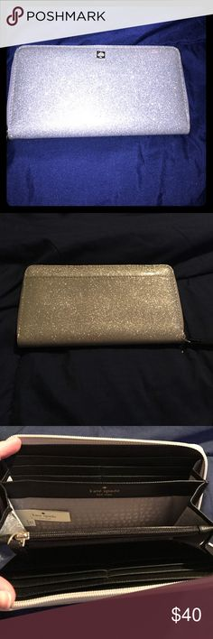 Kate Spade zip around wallet Kate Spade zip around silver wallet in excellent condition. kate spade Bags Wallets