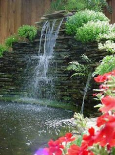 Pond Waterfalls - Here's a tall stacked stone pond wa...