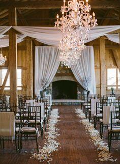 classic winter wedding ceremony decor | Photo by Laura Murray