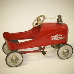 "Vintage red Murray ""Fire Chief"" pedal car with bell."