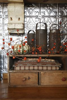 Rustic, beautiful autumn hues partnered with gorgeous tin work. #country #chic #decor #primitive #vintage