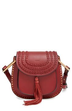 Free shipping and returns on Chloé 'Small Hudson' Studded Crossbody Bag at Nordstrom.com. Classic equestrian-inspired styling informs Chloé's sized-down crossbody, while golden studs amp up the modern appeal. With tonal braiding, a swishy tassel and adjustable strap, this contemporary bag will carry you stylishly through the week.