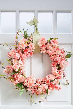 A few supplies from the crafts store are all you need to create this lasting spring wreath. #diyideas #homedecordiy #diywreath #frontdoordecor #bhg Diy Crafts For Gifts, Diy Arts And Crafts, Diy Craft Projects, Decor Crafts, Home Decor, Craft Ideas, Pink Wreath, Floral Wreath, Pink Cherry Blossom Tree