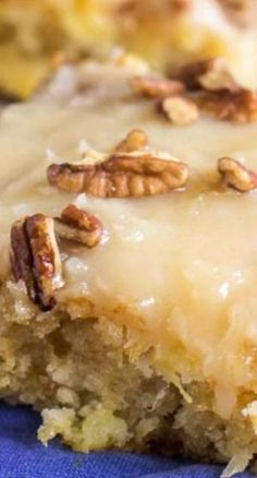 Pineapple Sheet Cake Recipe ~ flavored and moistened with crushed pineapple and topped with a sweet icing laced with shredded coconut, and sprinkled with pecans is a wonderful dessert to make to feed a crowd by jeanette