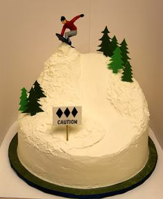 We both like this cake, only it would have to have both of us snowboarding on it. It's important that we look like actual snowboarders...