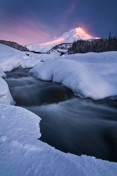"The Shining Mountain - A large winter storm dumped several feet of snow on Oregon's Mt. Hood before clearing at dawn.  The magenta ""clouds"" in the air are mostly windblown snow catching sunrise color.    <a href=""http://www.michaelbollino.com/Galleries/New-Work/"">Website</a>  