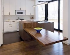 Cedarvale Residence by Taylor Smyth Architects  Wonderful table. Makes me want to re-design my kitchen just to be able to put this type of table in there.