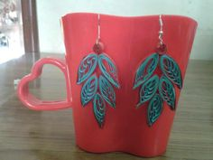 A Leafy design in green and red colours. Goes well with contrast colours and pure green and red as well. Maroon also goes well.