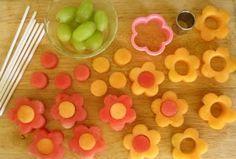 Fruit Flowers - put them on lollipop sticks & display in covered florist foam!