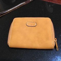 Wallet Like new. Mustard color. Wide zip opening. Rosetti Bags Wallets