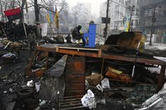 Ukrainian protester plays piano on a barricade in front of the riot police line during the continuing protest in Kiev, Ukraine on October 2, 2014.
