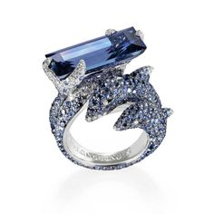 """Dolphin"" ring in white gold set with an emerald-cut blue sapphire of 13.07 carats, 153 white diamonds of 0.71 carat and 444 blue sapphires of 5.48 carats by de Grisogono"