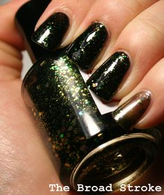 Elphaba is part of the For Good duo with her BFF Galinda. This dark and funky polish is a black jelly base filled with glitter in several sizes and shades of green, reminiscent of the wicked witch herself. Am still #wicked obsessed [: