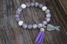 Archangel Michael Bracelet - $20 #Sugilite #Charms #Angel #Wings #Tassel #Protection #ArchangelMichael #StMichael #purple #lavender