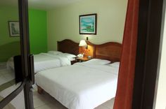 hotel lavas tacotal junior suite bed    - Costa Rica