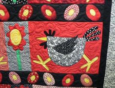 I really like the quilting on this cute chicken quilt.