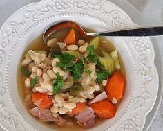 Ham and Beans, an easy, one-pot supper, great for a leftover ham bone. Picture shows, the first bowl, before the beans begin to turn creamy. For Weight Watchers, #PP5. High protein!