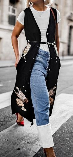 When layering over your denim, it's all on the hem. Loewe has you covered. Like @beigerenegade, get the wardrobe staple on Farfetch now.