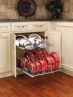 This is how pots and pans should be stored. Lowes and Home depot sell these. @ Home Design Ideas