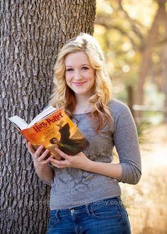 Senior girl reading Harry Potter Book. Oh my gosh, I need this. @Bree Lee