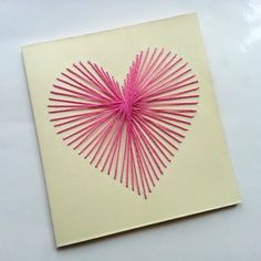 Create a Beautiful String Art Heart Card. Learn how with the free Guidecentral app!