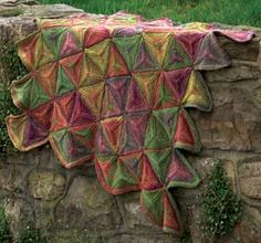 Modular triangular throw...love the colours as well as the pattern...