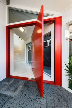 Chic Residence with Neutral Palette and Accents in a Vibrant Red  by the Perth-Based Cambuild