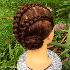 Two dutch lace braids into a braided bun