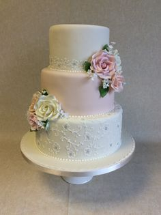 Fenella - 3 tier pretty pale peach and ivory wedding cake with white and silver brush embroidery detail and sugar roses