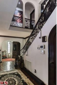 Sprawling: The mini castle features cast iron banisters and cool stucco walls for the searing Hollywood Hills temperatures