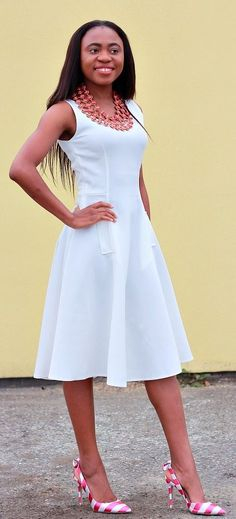 Really love this sleeveless flare dress and how she paired it with a pair of striped bow heels. It is definitely a flattering style.   Summer dress   Fall style   Summer fashion   White dress   Fall outfit   Fall fashion