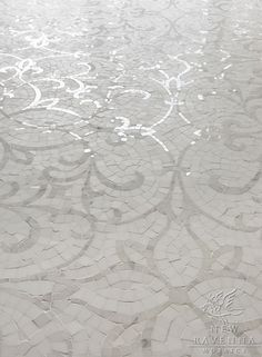 Marabel Floor shown in honed Thassos and polished Calacatta Tia.