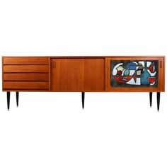 Exceptional Teak Sideboard with Art Tile Panel Sliding Door by Vigneron   From a unique collection of antique and modern credenzas at https://www.1stdibs.com/furniture/storage-case-pieces/credenzas/
