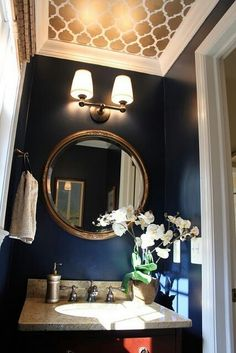 Half bathroom/small space idea. Navy blue walls w/ patterned ceiling in a different color, white crown molding. Easy stenciling  project. Using 2 colors with molding draws your eye up.