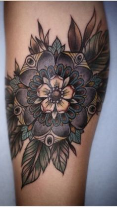 Flower tattoo with feathers
