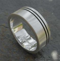 180cce8164ac Black etched two lines around one edge of silver ring. 125GBP.