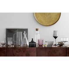 Shop eloise double old-fashioned glasses.   Handmade with substantial heft, cut-glass inspired sippers are embossed with a repeating chevron texture that reflects the glamour of retro entertaining.