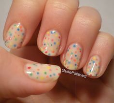Layered dots nail art design -- Confetti nails! One coat of Love & Beauty Cream (a very sheer white), three dots each of OPI Bullish on OPI, Essie Orange, It's Obvious!, Sinful Colors Pull Over, Julep Leah, and Sally Hansen Blue Me Away! on each nail. Then two more coats of Cream, another round of dots, then another two coats of Cream.