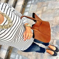 IG @mrscasual <click through to shop this look> Nordstrom ($20) striped long sleeve tee. Old navy cropped boyfriend jeans. Scalloped flats statement necklace cognac tote bag.