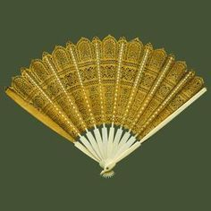 Fan from the Stuart Collection; pierced and gilded leather; c. 1600.